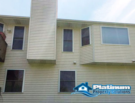 after view of clean vinyl siding with platinum property solutions house washing service in grand rapids, mi
