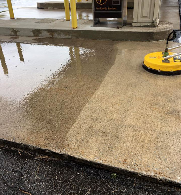 cleaning a concrete pad on a commercial driveway in grand rapids, mi