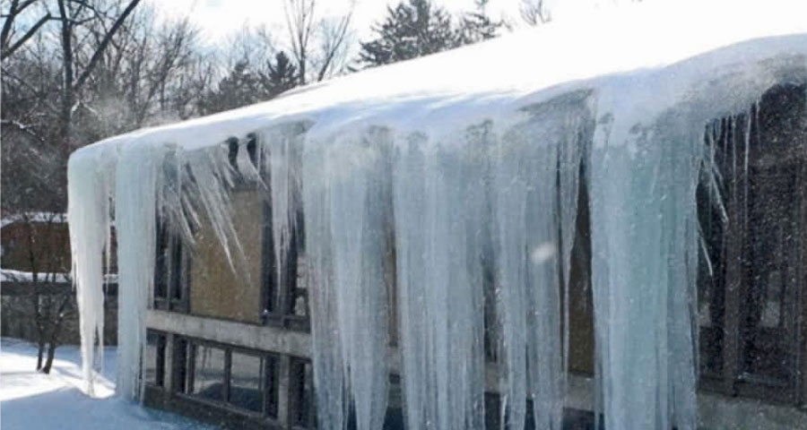 ice dam removal of large icicles on roof in grand rapids michigan