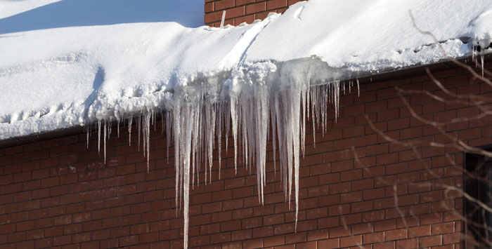removing ice dams on house in grand rapids michigan